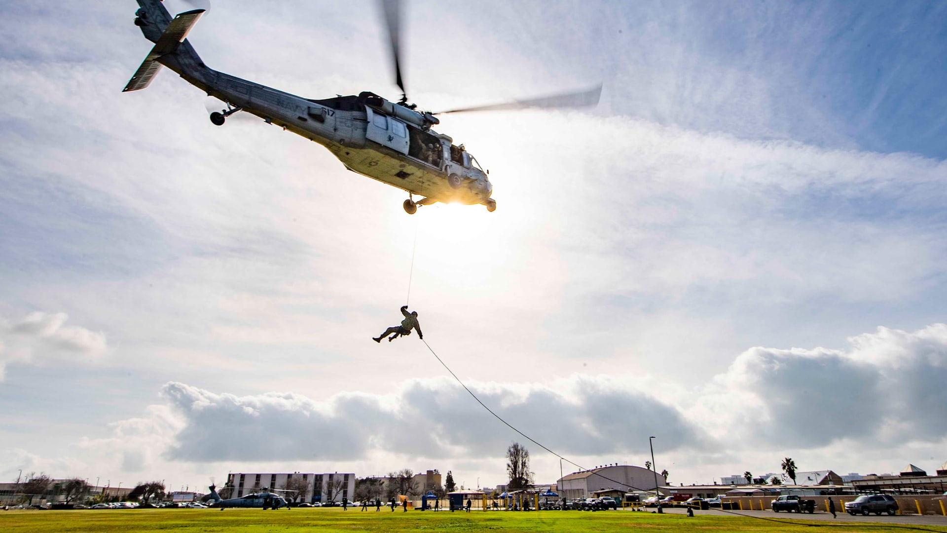 A Navy MH-60S Seahawk hovers during helicopter rope suspension training with sailors at Naval Amphibious Base, Coronado, California, February 16, 2021.
