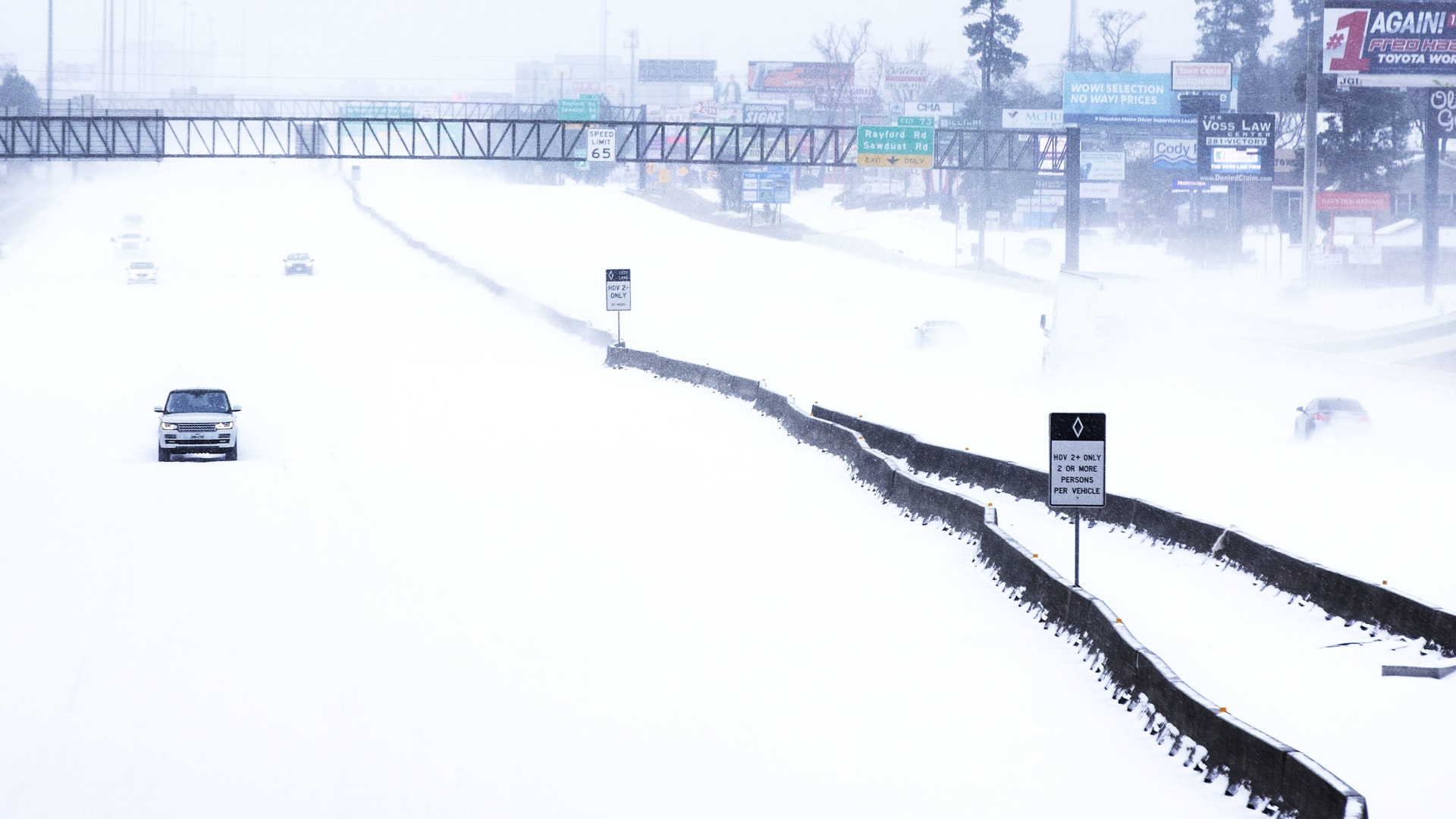 Traffic is sparse on the snow-covered I-45 near The Woodlands Parkway following an overnight snowfall Monday, Feb. 15, 2021 in The Woodlands, Texas.