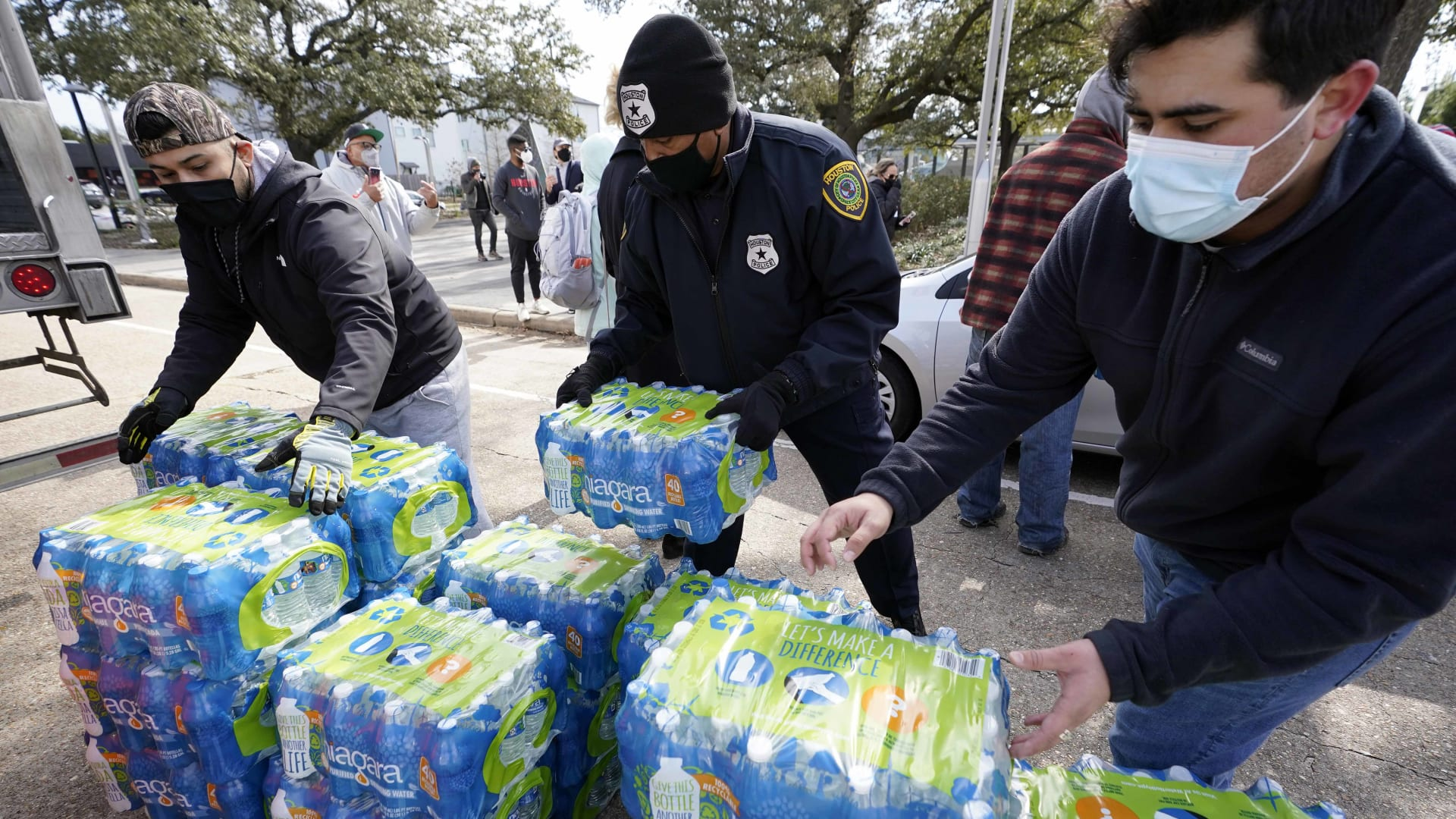 Donated water is distributed to residents, Thursday, Feb. 18, 2021, in Houston.