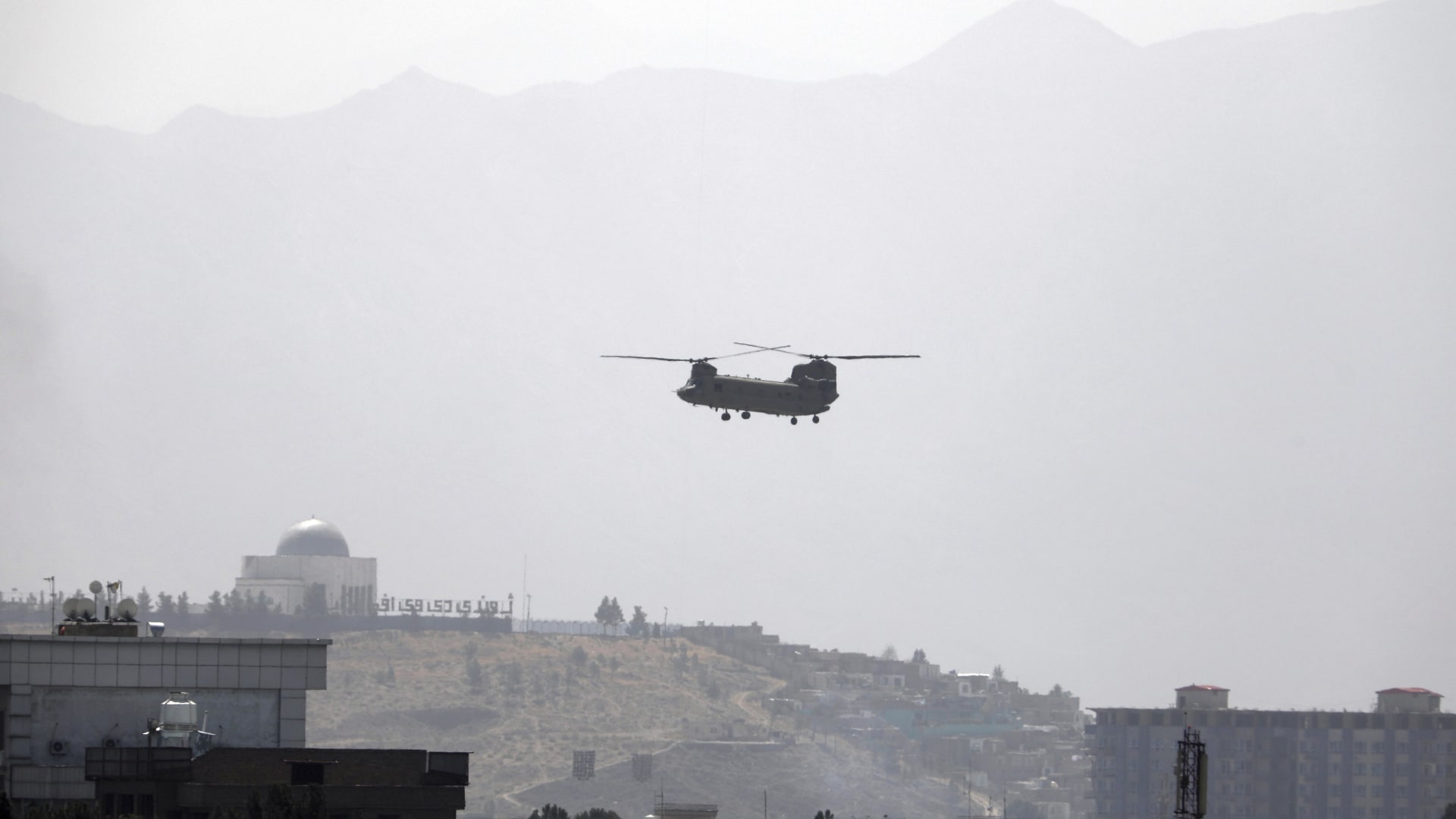 A U.S. Chinook helicopter flies over the U.S. Embassy in Kabul, Afghanistan, on August 15, 2021.