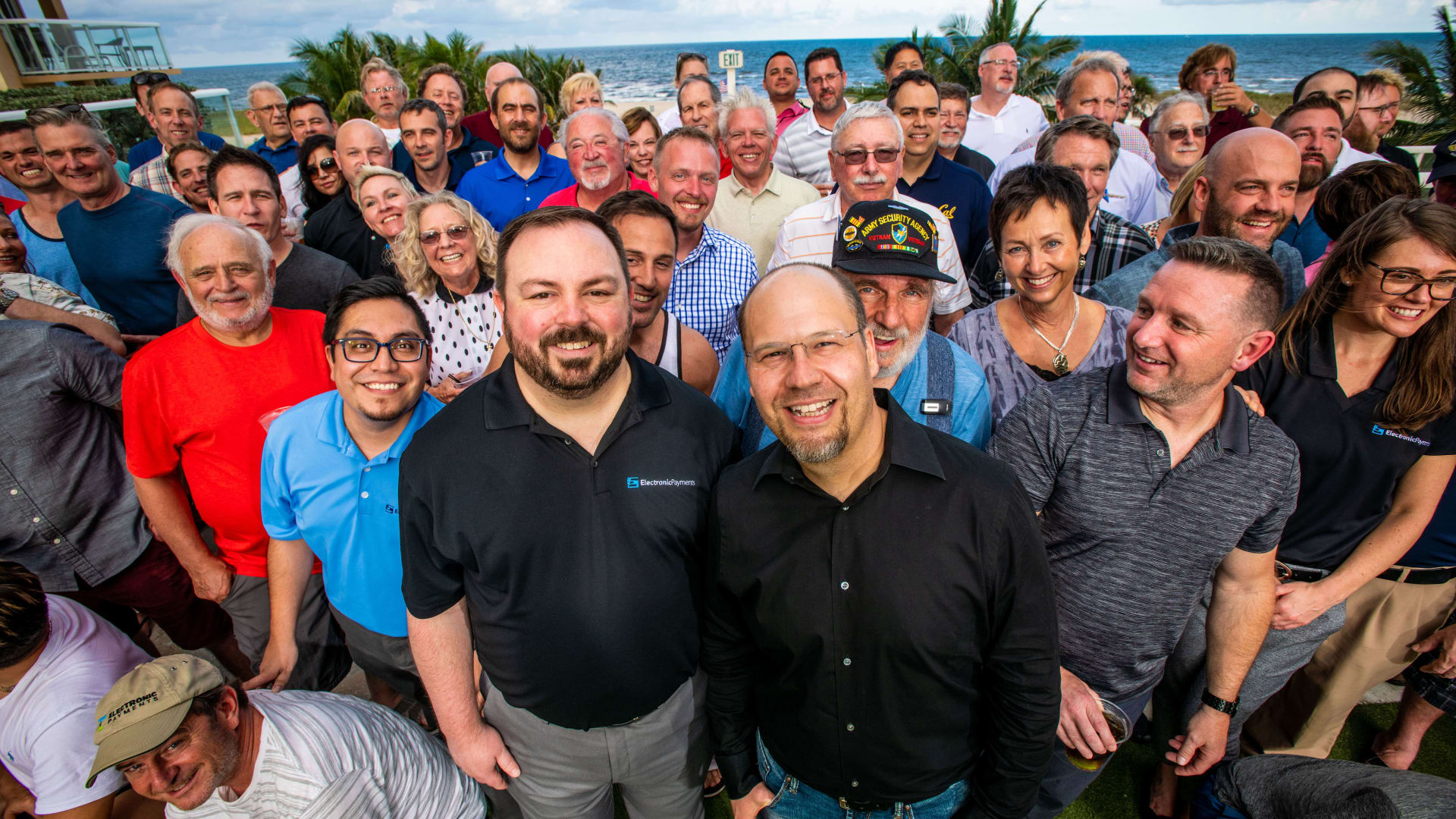 Michael Nardy, CEO (front center right), Matthew Findlan, COO (front center left), and team
