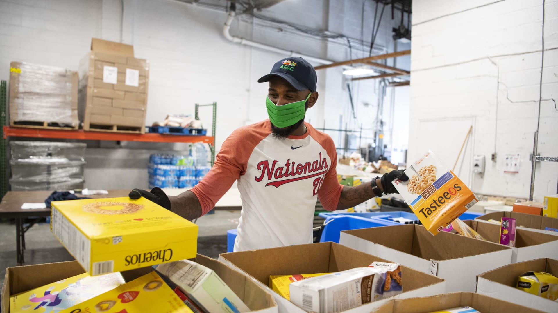 Warehouse manager Ray Bynum sorts cereal at the Arlington Food Assistance Center in Arlington, Virginia.