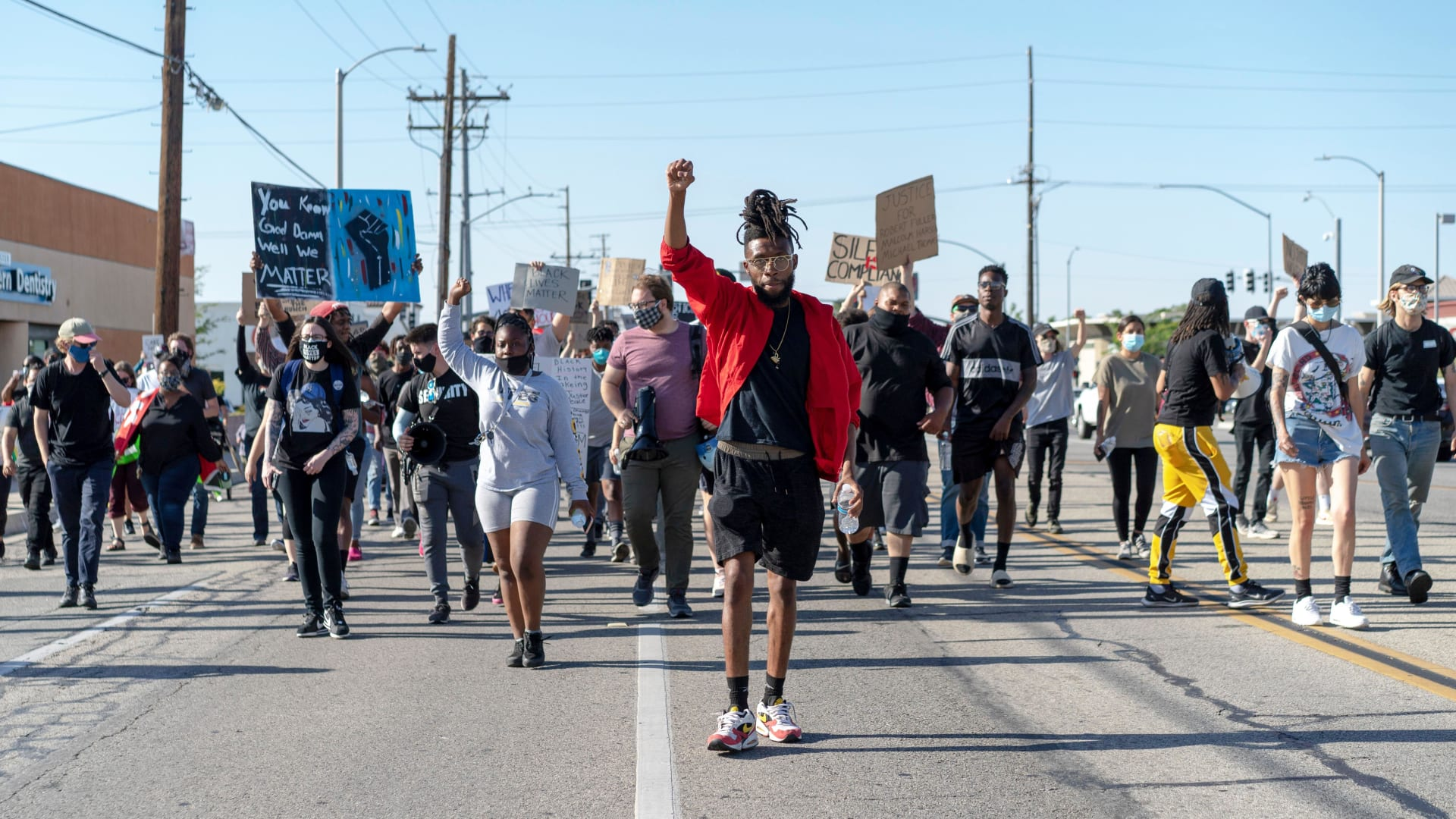 Activist Ayinde Love (center) leads a crowd of protesters during a Juneteenth demonstration  in Lancaster, California.