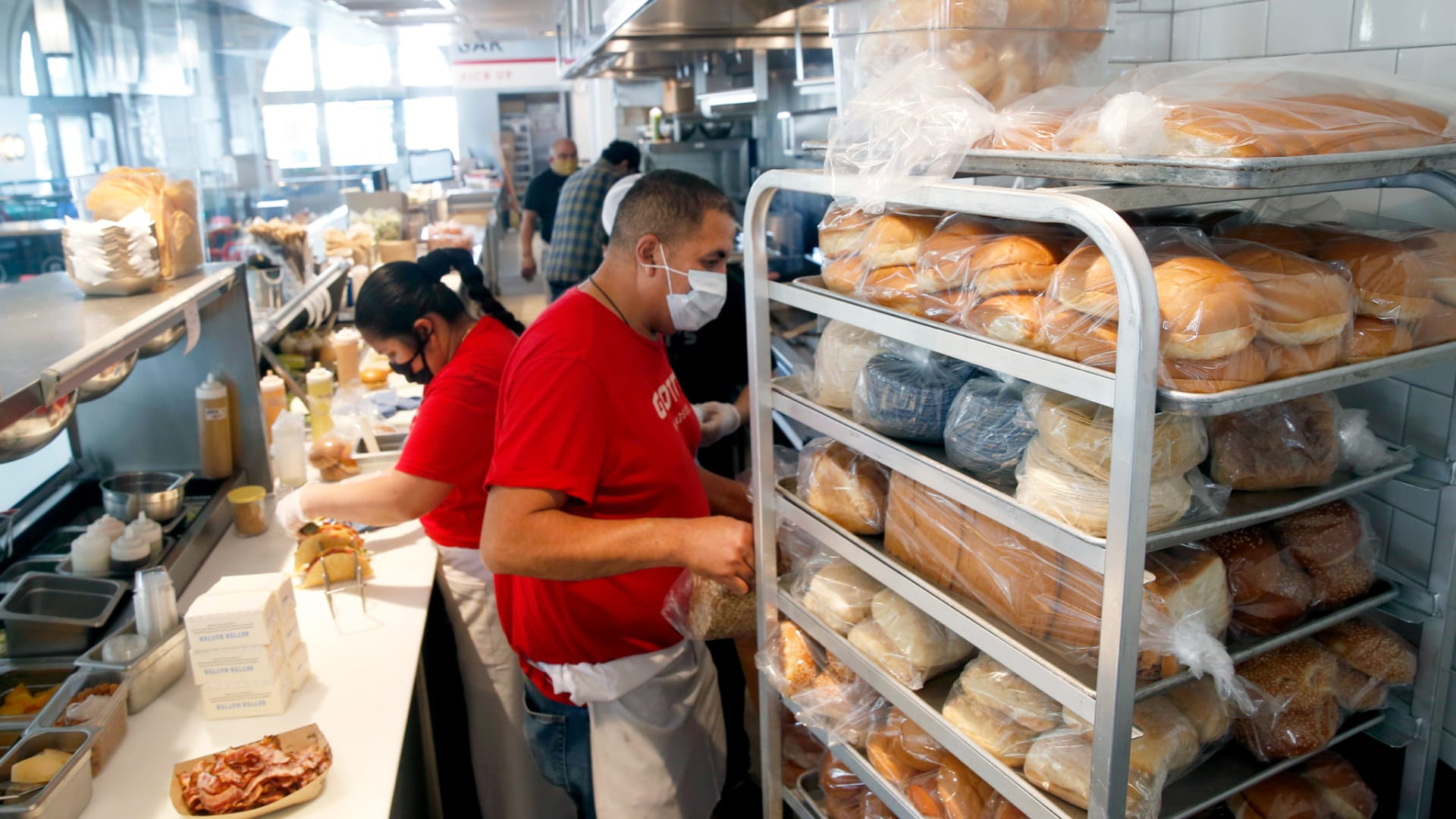 The kitchen staff prepares lunches at Gott's Roadside restaurant at the Ferry Building in San Francisco on Saturday, May 2, 2020.