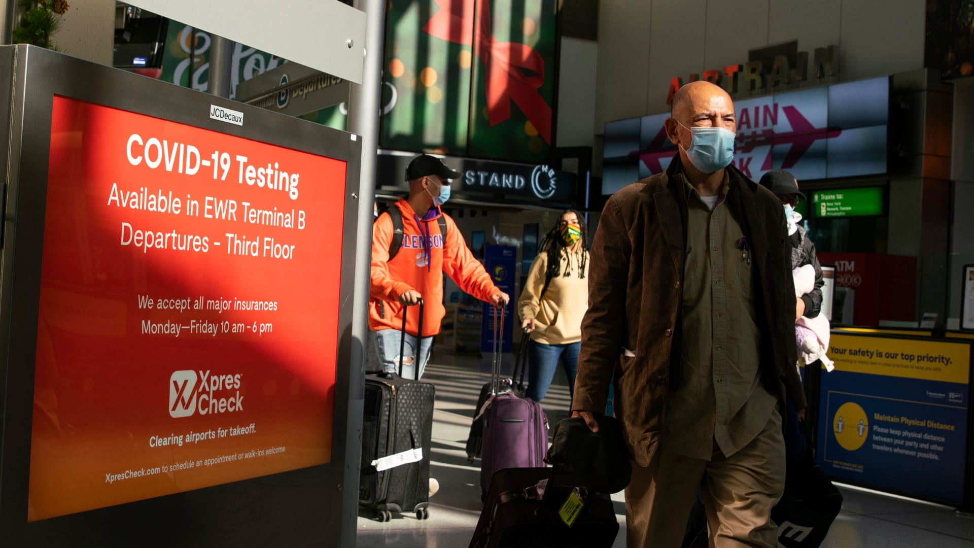 Travelers walk through Newark Liberty International Airport.