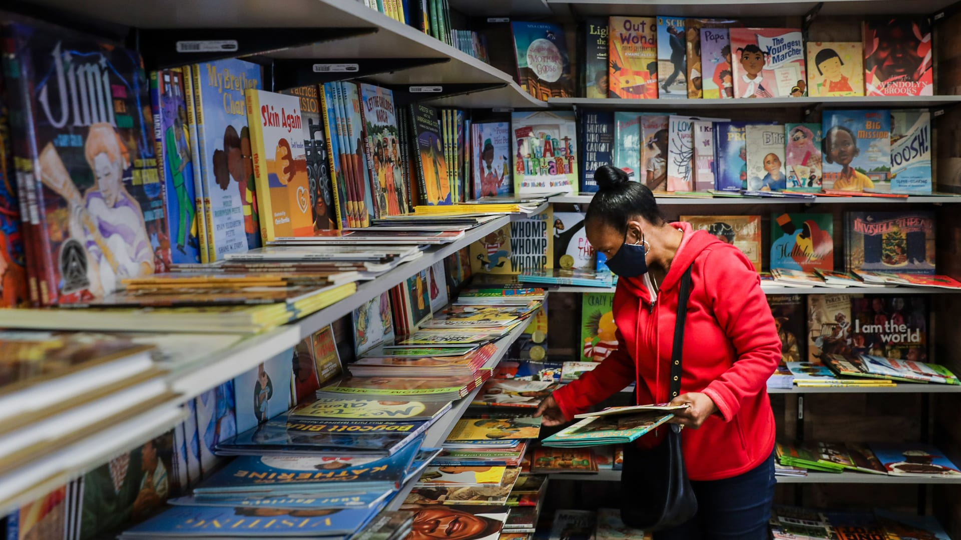 A patron browses in the children's book section at Frugal Bookstore, the only Black-owned bookshop in Boston.