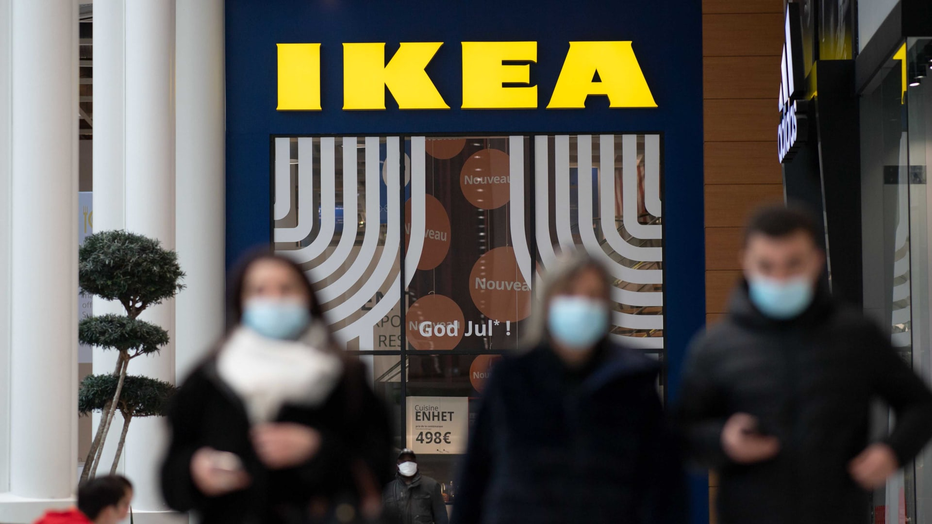 People walk outside the entrance of Scandinavian furniture chain store Ikea on January 13 in Saint-Herblain, outside the city of Nantes in France.