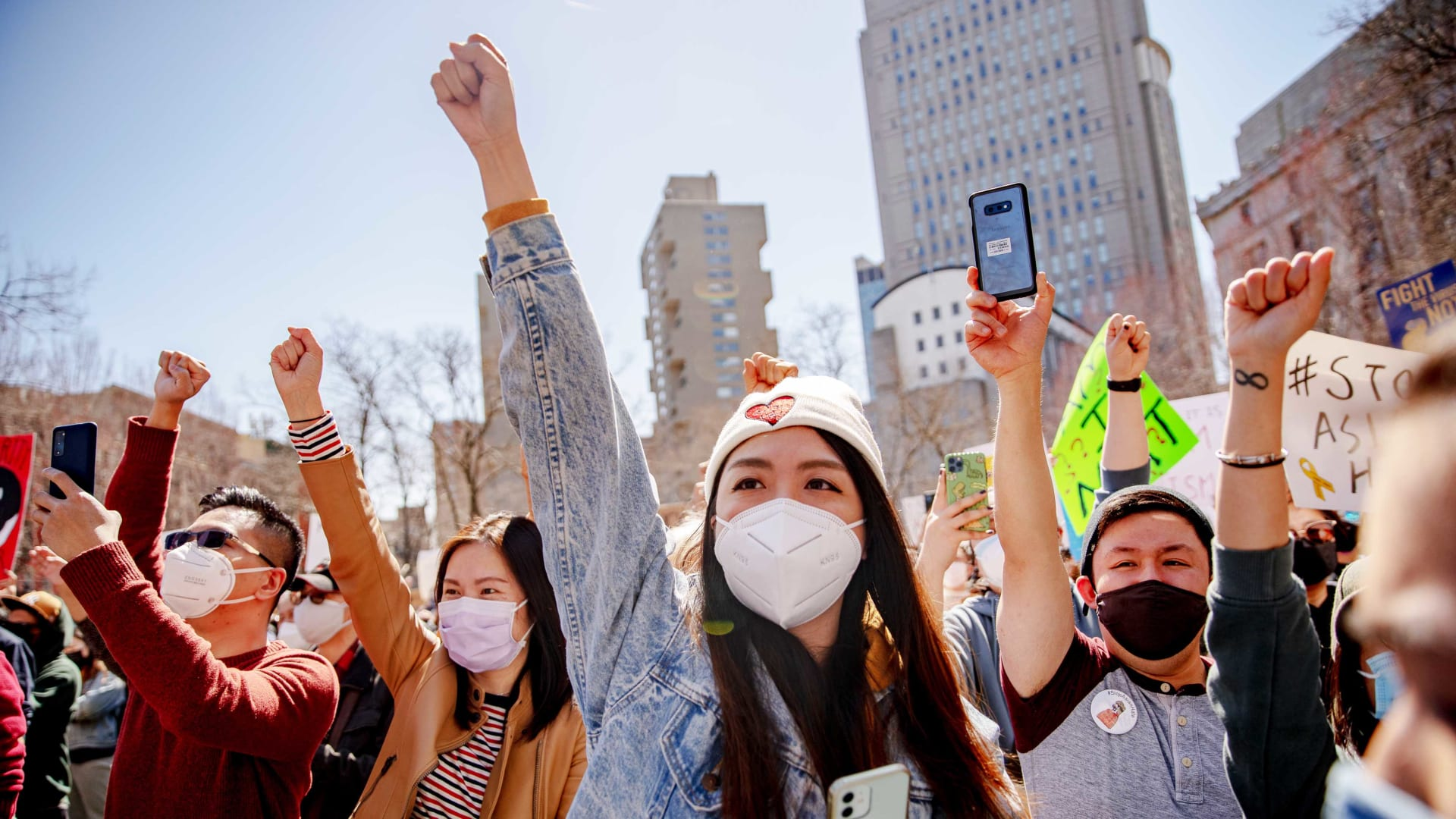 Demonstrators raise their fists during an AAPI Rally Against Hate in New York City on March 21, 2021.