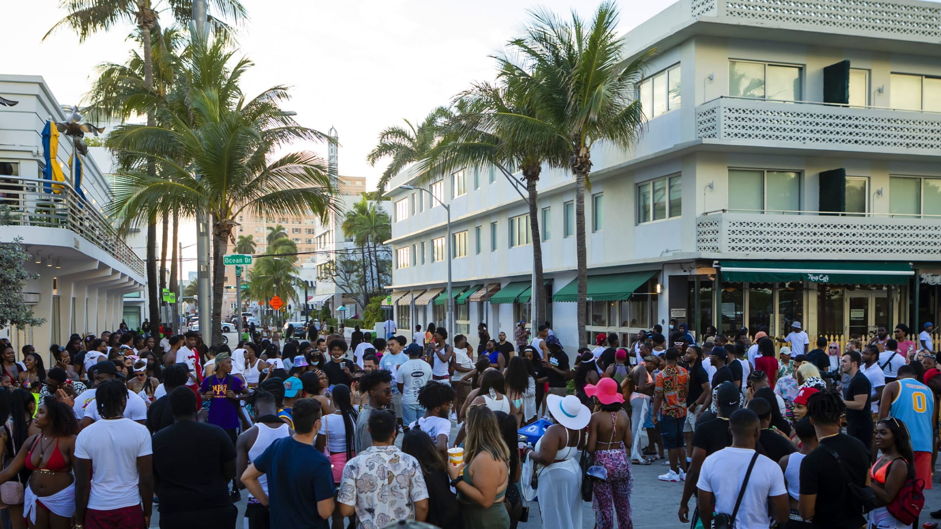 A crowd of people walk along Ocean Drive in the South Beach neighborhood of Miami on Saturday, March 27, 2021.