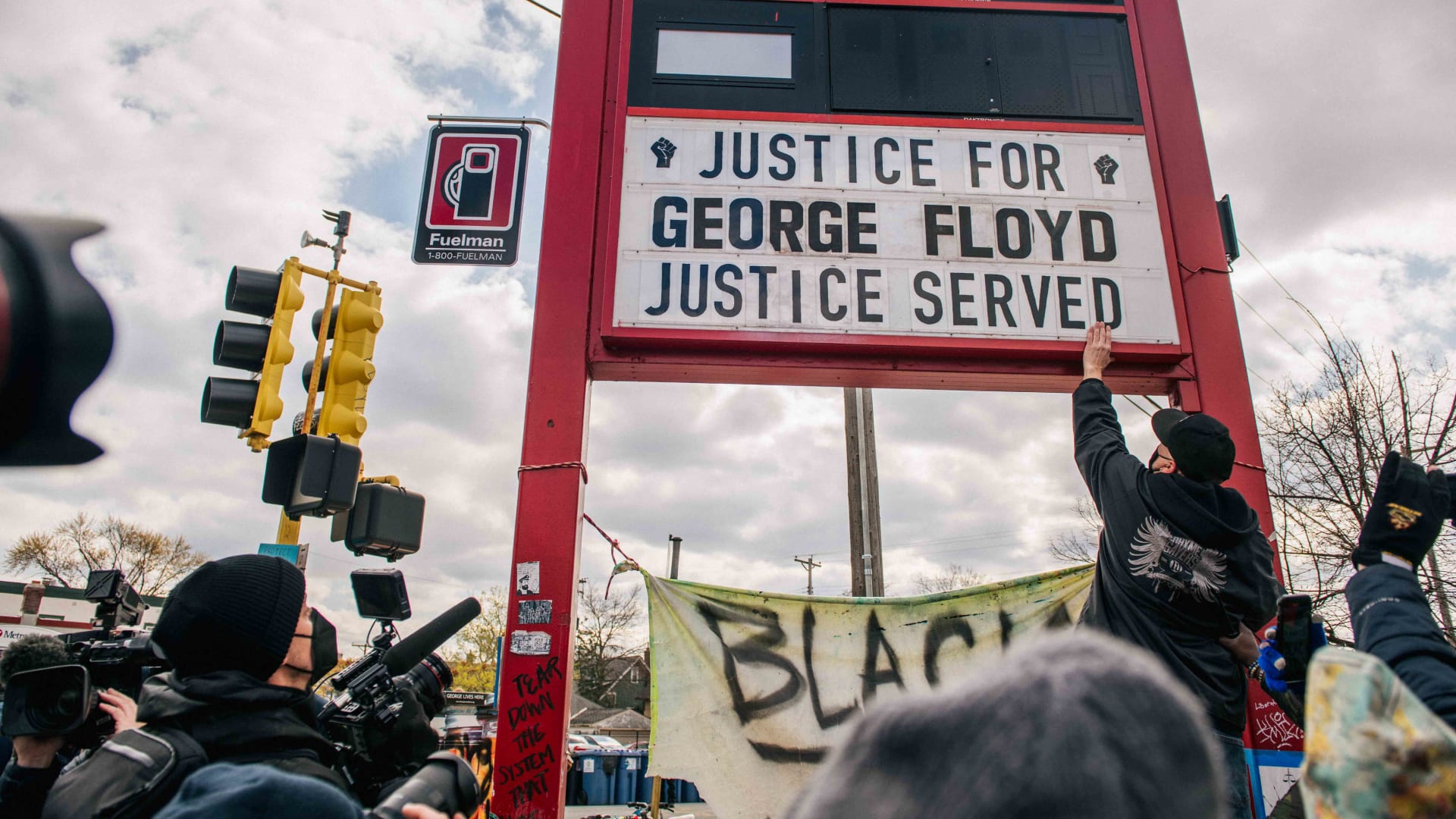 People celebrate the guilty verdict in the Derek Chauvin trail at the intersection of 38th Street and Chicago Avenue on April 20, 2021 in Minneapolis, Minnesota.