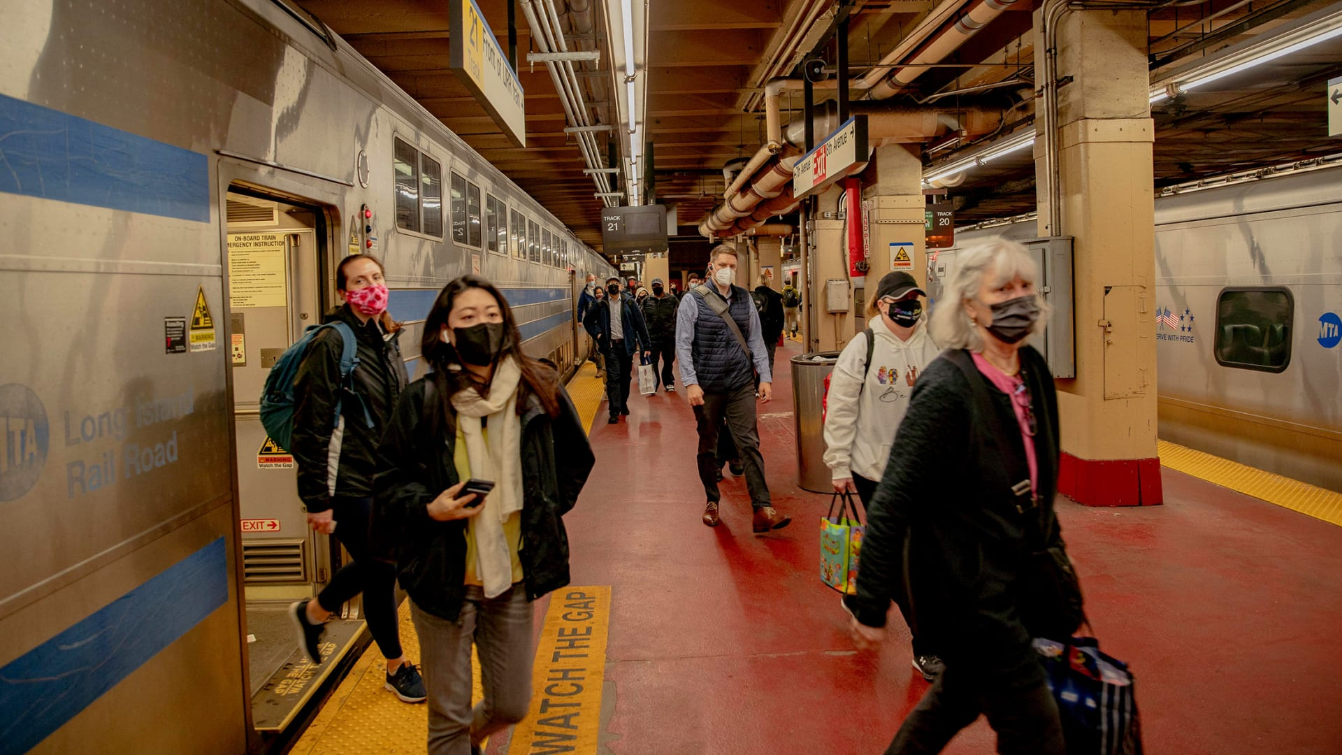 Commuters exit a Long Island Rail Road train at Pennsylvania Station in New York in May.