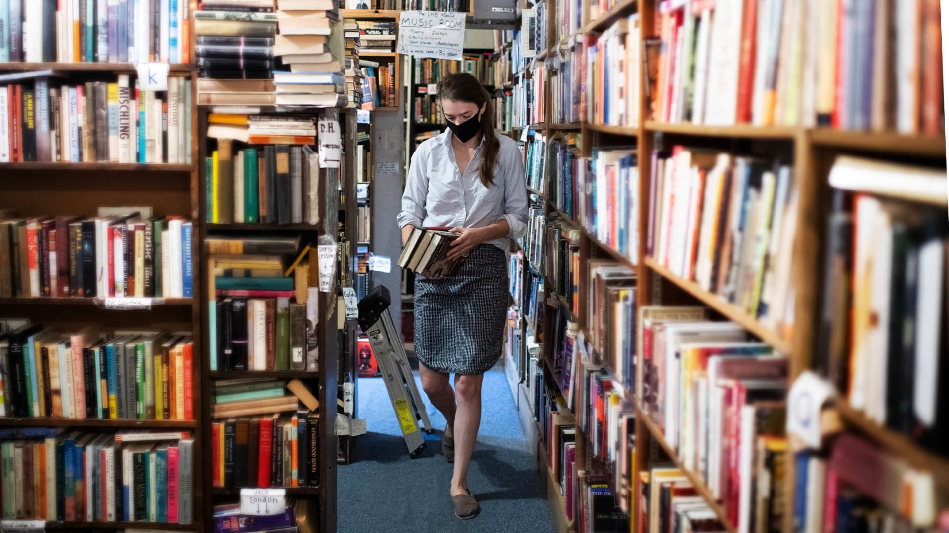 Hélène Golay stocks inventory at Capitol Hill Books in Washington, D.C., on June 1, the day the store reopened to indoor customers after being closed for several months because of Covid-19.