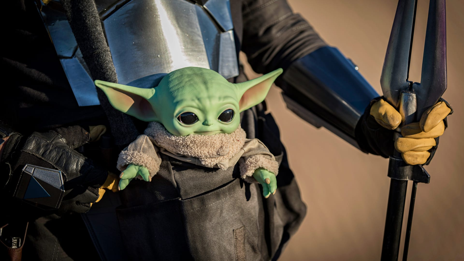 A Grogu action figure from Star Wars: The Mandalorian at Buttercup Sand Dunes on February 21, 2021 in Winterhaven, California.