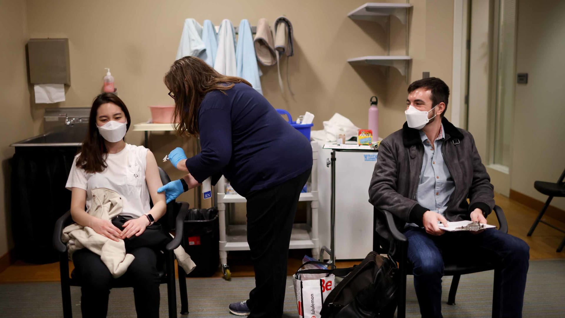United Airlines flight attendants  receive COVID-19 vaccines  at United's onsite clinic at O'Hare International Airport