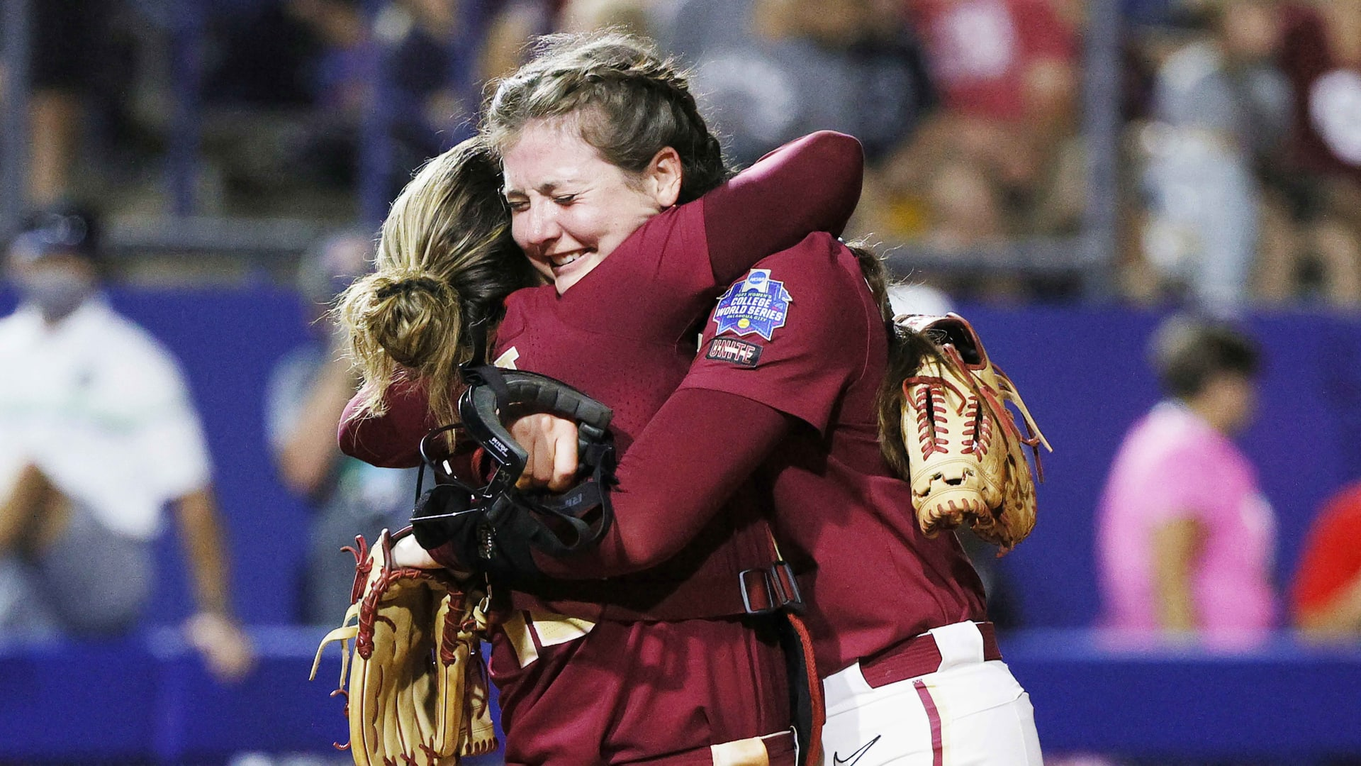 Kathryn Sandercock (right) and Anna Shelnutt of the Florida State Seminoles celebrate their Game 1 win at the Women's College World Series Championship against the Oklahoma Sooners on June 8, 2021, in Oklahoma City, Oklahoma.