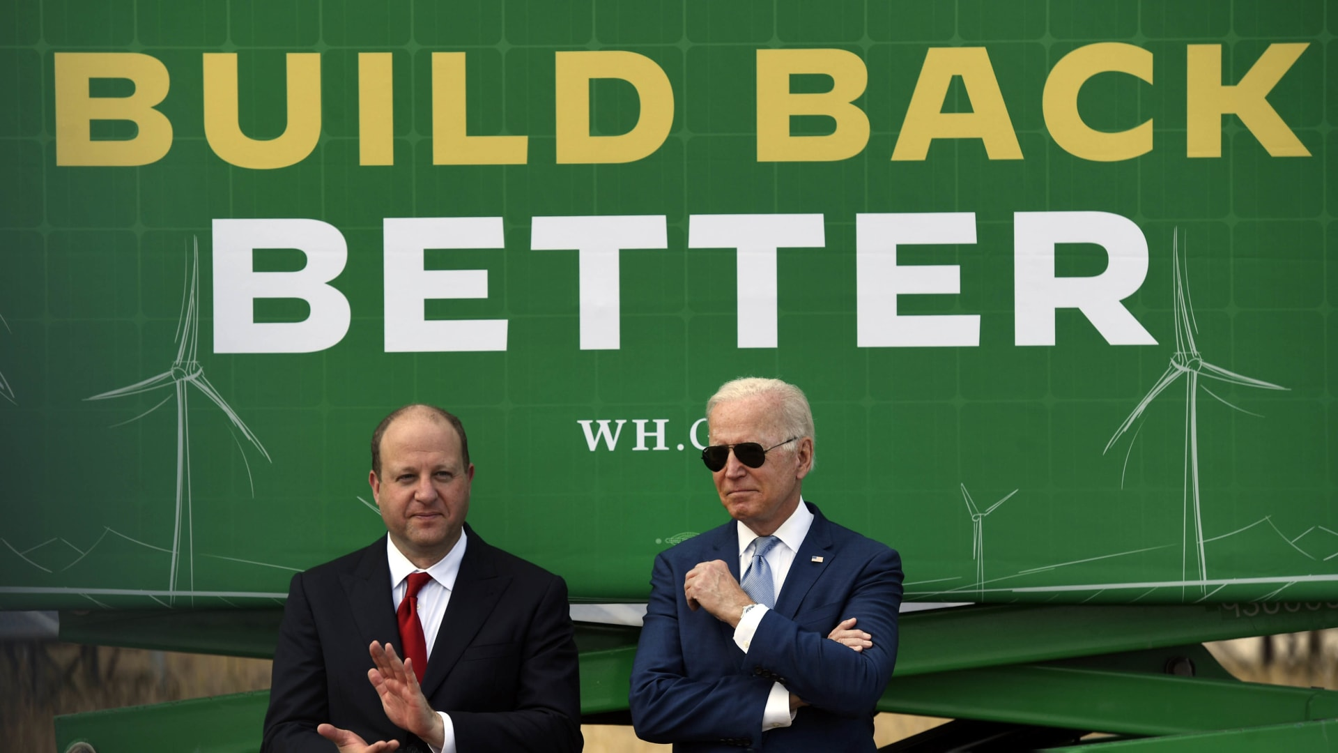 President Joe Biden, right, stands next to Colorado Governor Jared Polis on the grounds of the National Renewable Energy Laboratory on September 14 in Arvada, Colorado.