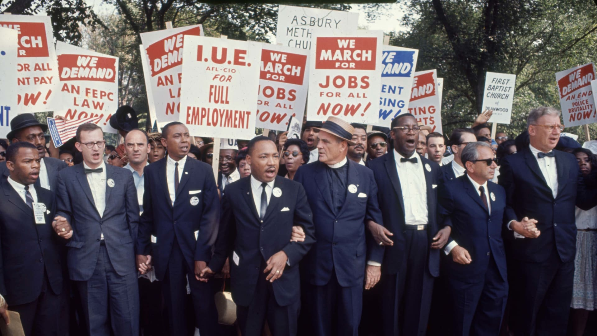 View of some of the leaders of the March on Washington for Jobs and Freedom, in Washington, D.C., on August 28, 1963. Among those pictured are, front row from left, John Lewis, Mathew Ahmann, Floyd B. McKissick (1922-1991), Dr. Martin Luther King Jr. (1929-1968), Reverend Eugene Carson Blake (1906-1985), Cleveland Robinson (1914-1995), and Rabbi Joachim Prinz (1902-1988) (in sunglasses). The march provided the setting for Dr. King's iconic 'I Have a Dream' speech.