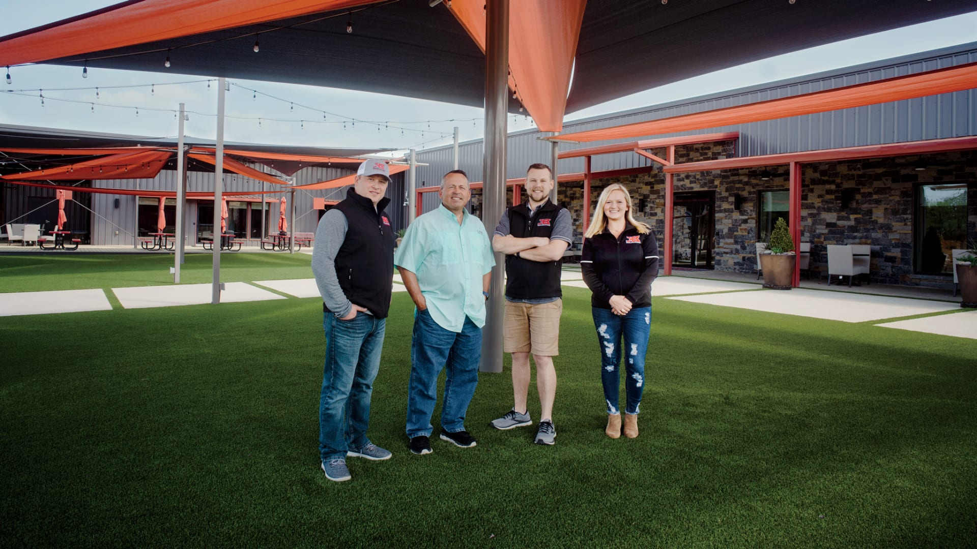 Members of the Bohannan family at the company's new HQ, which has a music venue, twin fire pits, and, soon,  a swimming pond.