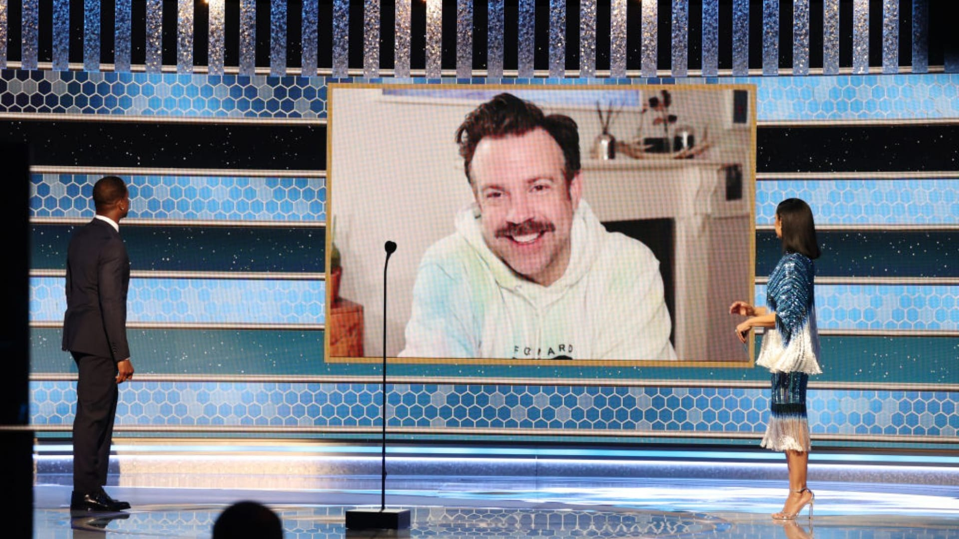 """Jason Sudeikis speaks remotely at the 2021 Golden Globes awards ceremony after being named Best Actor in a Television Series Musical or Comedy for his role in """"Ted Lasso."""""""