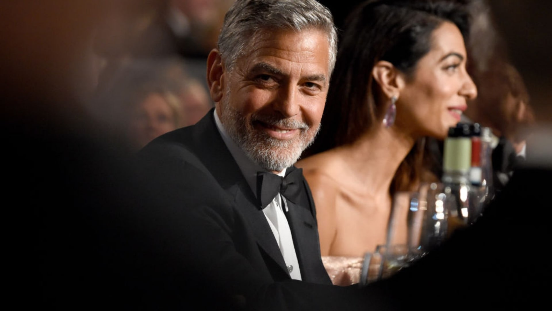George Clooney and his wife, Amal Clooney.
