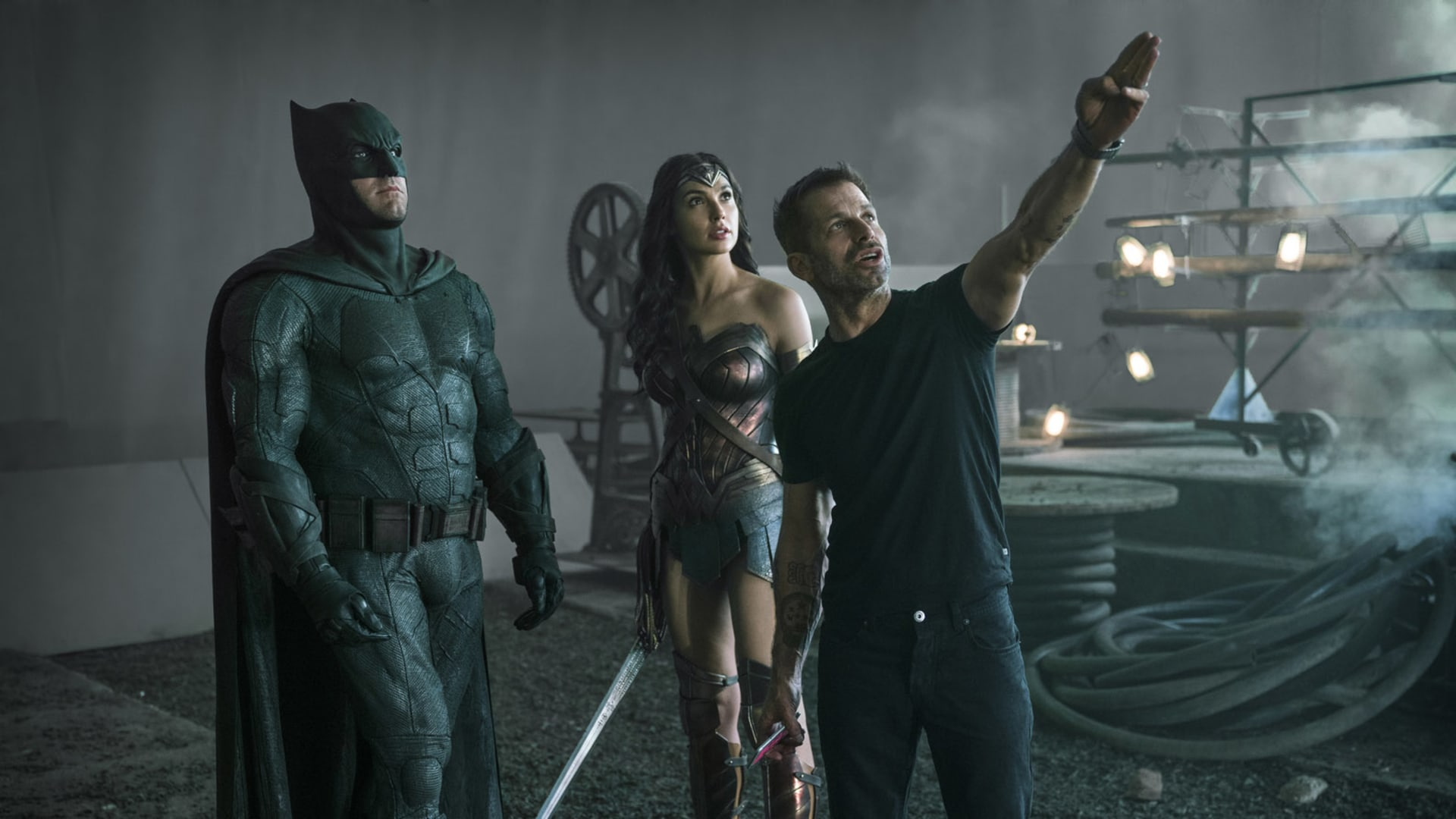 Director Zach Snyder on the set of 'Justice League,' with Ben Affleck and Gal Gadot.